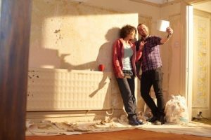 couple inside remodeling a home