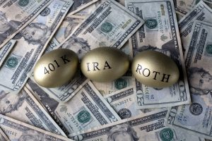 Gold painted eggs; 401K, IRA, ROTH on top of cash